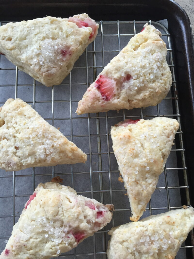 strawberry scone with rhubarb glaze on cooling rack