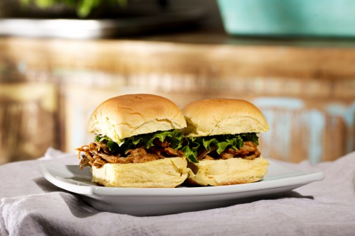 slow cooker pulled pork on bun with lettuce