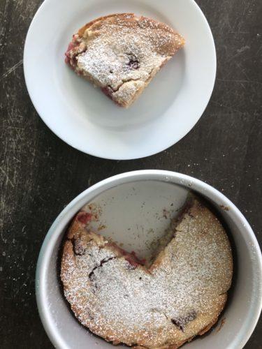 Raspberry Yogurt Cake slice and full cake in bowl