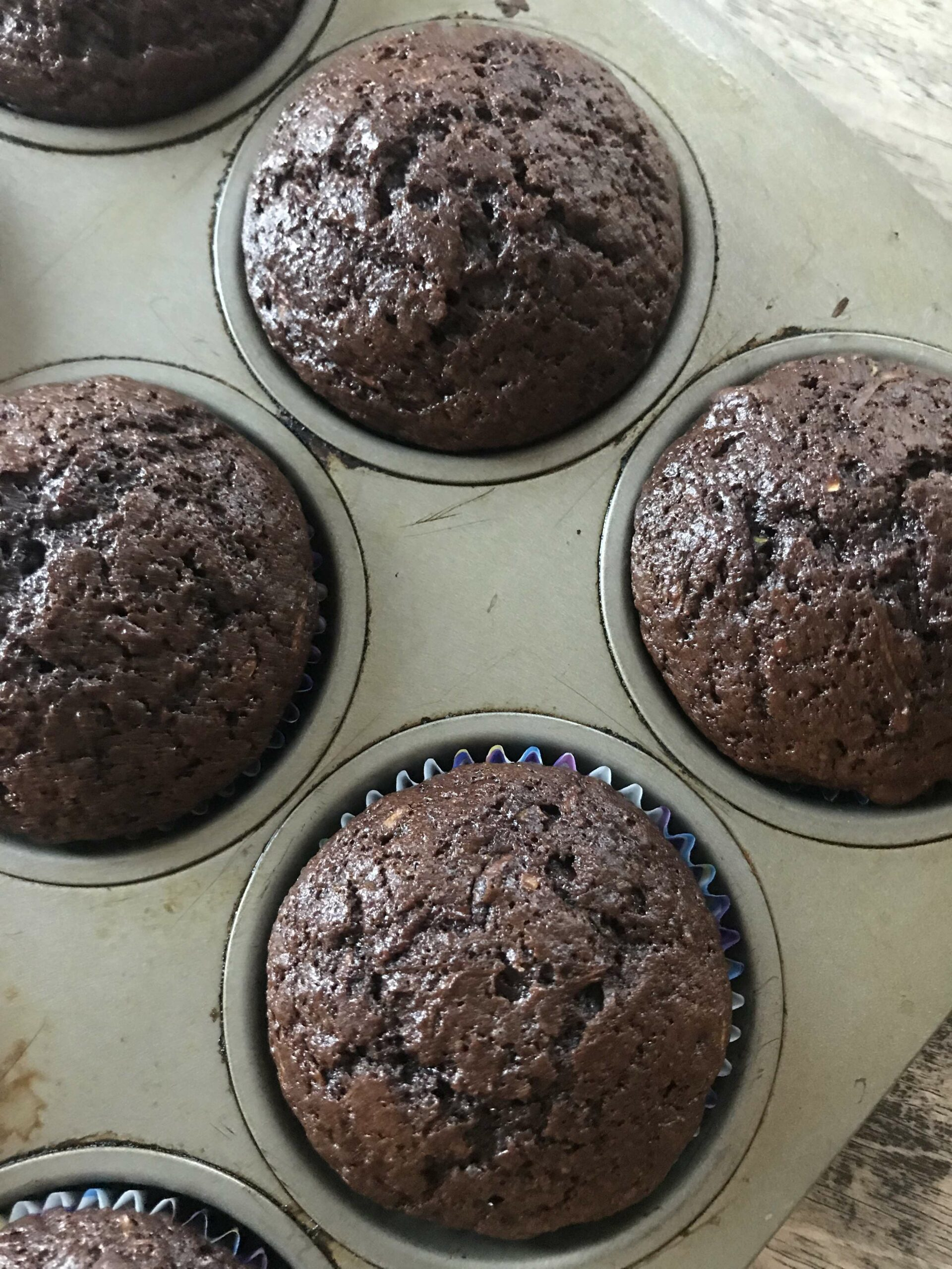chocolate zucchini muffins in baking pan