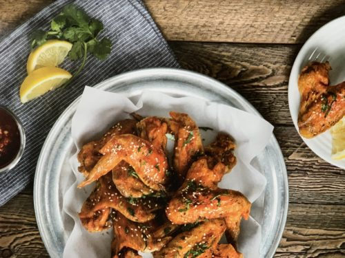 air fryer sriracha honey chicken wings on rustic table