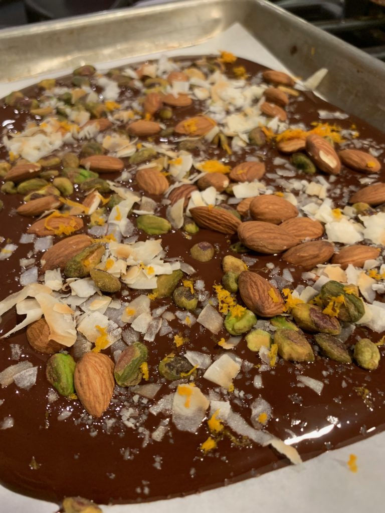 chocolate bark with almonds, pistachios, coconut, and cinnamon